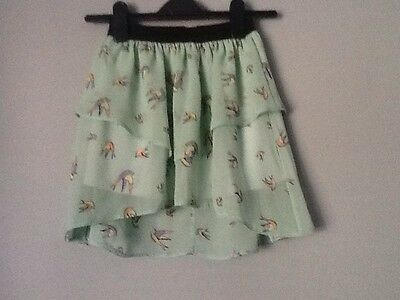 Girls pretty skirt. Pale green with bird print. Age 7