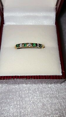 Emerald and diamond eternity ring 9ct gold