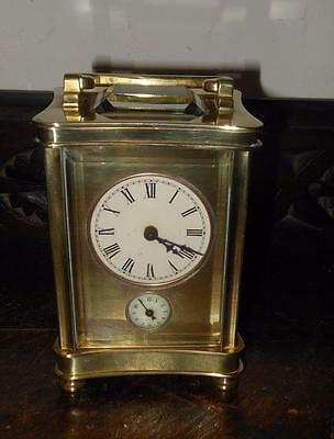 french wavy shaped brass cased carriage clock alarm