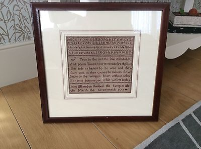 Original Geo111sampler on linen in red thread signed dated 1773 framed .