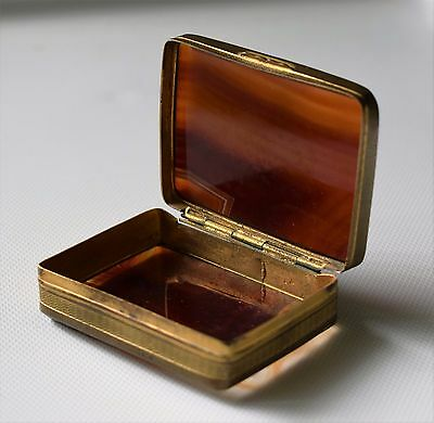 A 19th century brass mounted agate snuff box.