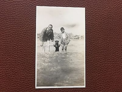 1935 Real Photograph Postcard Man & Boy with Dog on Beach Skegness