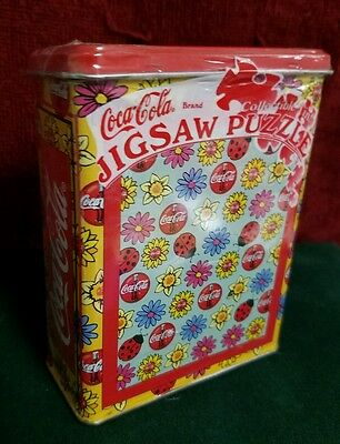 """Coca-Cola Jigsaw Puzzle in Collectible tin - 75 Piece  7""""  X  9"""". New, sealed"""