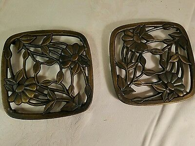 Pair of metal Princess House trivets with floral design