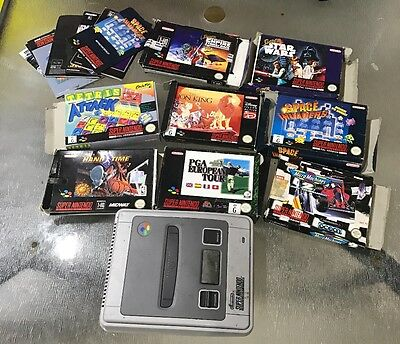 super nintendo and 8 boxed games