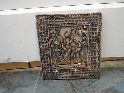 quirky unusual ethnic resin plaque depicting wrestling figures  odd wall hanging