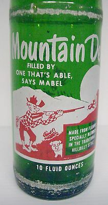 "1965 Mountain Dew Filled By ""One That's Abel Says Mabel"" 10 ounce Soda Bottle"