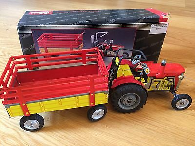 BNIB Schuco 07041 TIN TOY TRACTOR with GEARS and TRAILER Made in Germany RARE!