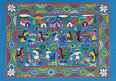 Mexican embroidery depicting village scene