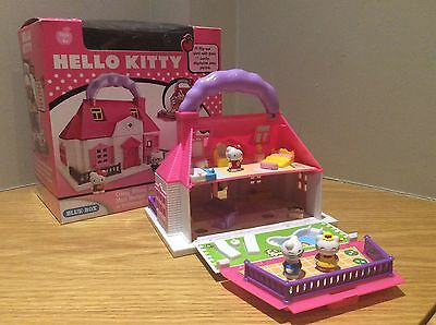 Hello kitty carry along mini doll house with box