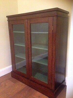 Victorian cabinet 19c MAHOGANY bookcase with pair of glazed panel on plinth base