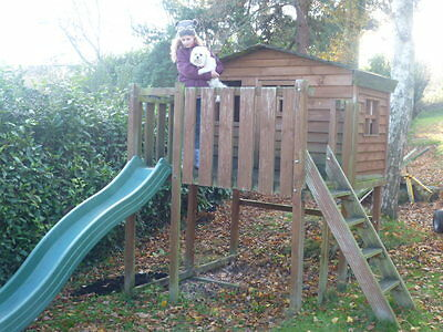 Childrens raised Wooden Playhouse and slide