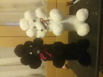 Pair of knitted poodle bottle covers