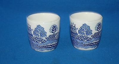 Two blue and white willow pattern egg cups