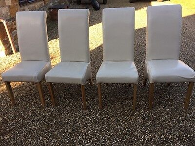 cream leather dining chairs x 4