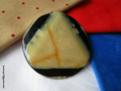 3309-I – Laminated Celluloid Rounded Corner Triangle Large Vintage Button
