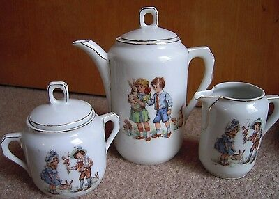 Antique Child's china Germany Children with Bunnies 23 Piece