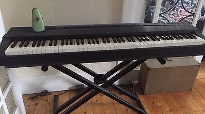 Yamaha P70 keyboard, 88 keys, with music rest and stand