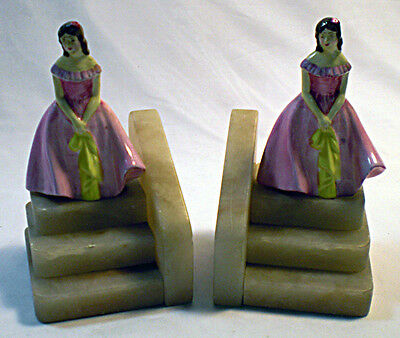 A pair of hand painted porcelain and marble Art Deco bookends
