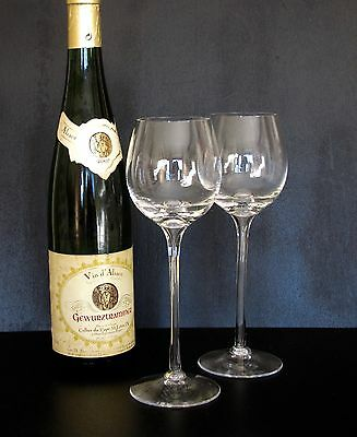 A pair of quality, hollow stem hock glasses.