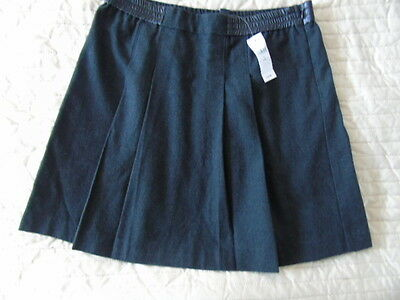 New with tags.Gap Skirt. Dark Grey. Age 13 years.