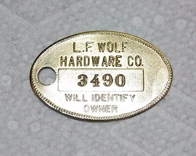 Vintage Charge Coin L.F. WOLF HARDWARE Mt Clemens MI; Coin