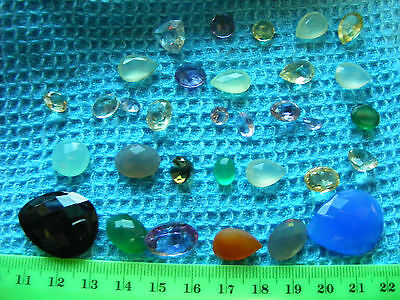 Lot of 32  Faceted Gemstones,natural mined stones.Wide variety of gems & colors.
