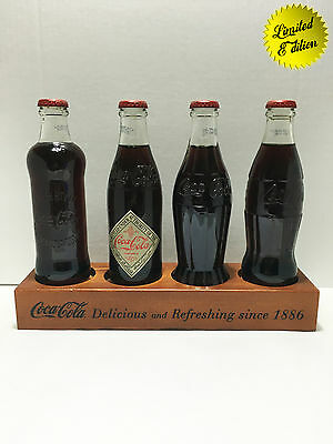Coca-Cola bottle completed set with wooden stand. 125 anniversary of Coca-Cola.