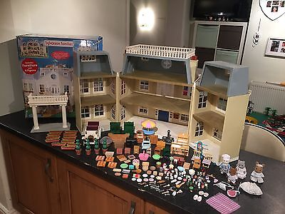 Sylvanian Families Hotel With A Collection Of Figured And Accessories