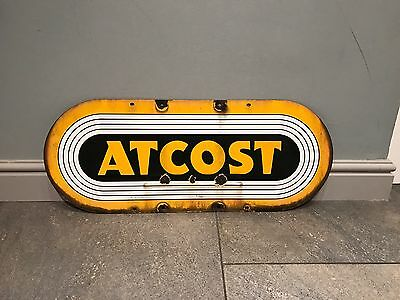 """LOVELY VINTAGE 1950s """"ATCOST"""" ENAMEL METAL ADVERTISING WALL SIGN."""