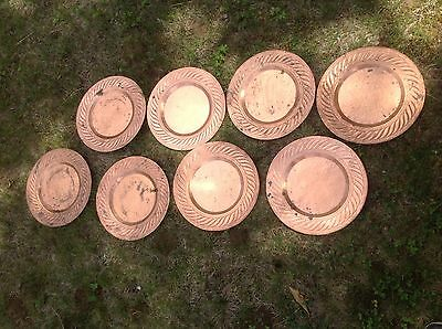 Arts and crafts era hammered and punched copper plates  set of eight