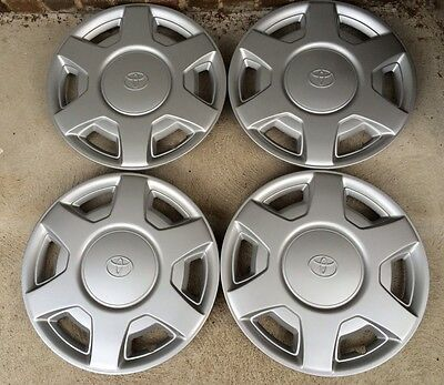 "TOYOTA CAMRY-TARAGO RV Getaway HUB CAPS..15 "" SET OF 4...GENUINE"