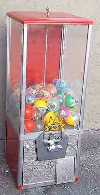 capsule vending machine (vends any 2 inch capsules like the picture)