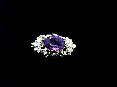 Antique Victorian 14 Carat Gold & 2 Carat Oval Cut Amethyst Repousse Brooch