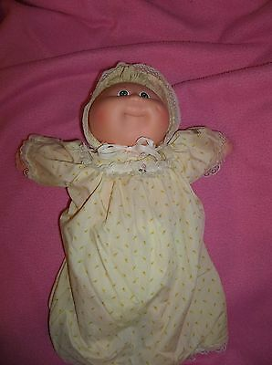 Cabbage Patch preemie by Coleco 1980s with yellow sleeper outfit