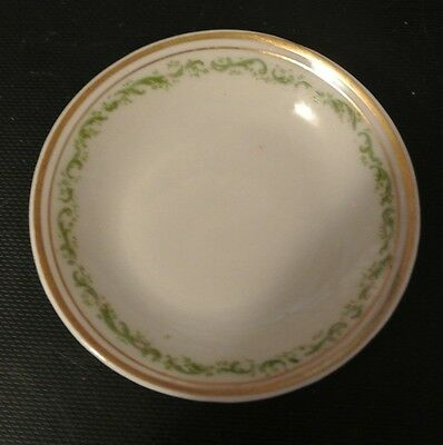 """Butter Pat with Green leaves and gold trim. 3"""""""