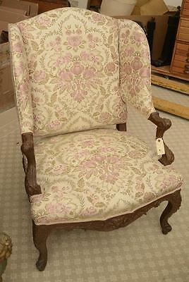 Nicely carved fruitwood wing back chair Lot 51