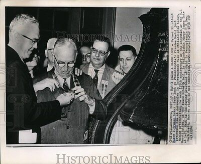 1962 Wire Photo Former President Harry S. Truman looks at Freedom Medal.