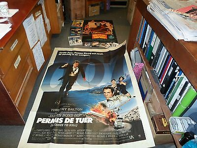 massive james bond collection ,over 20 posters, postcards, games,book,tapes,prop