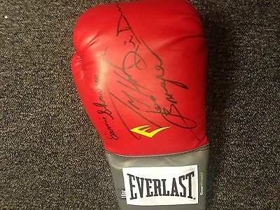 Muhammad Ali Tribute glove signed by Opponents Holmes Shavers Bugner Dunn