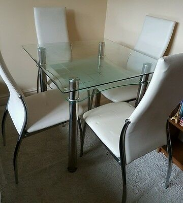Glass dining table and 4 leather effect chairs
