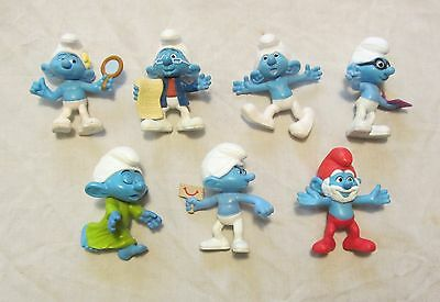 7 assorted plastic Smurf figures, 7.5cm high in good condition.