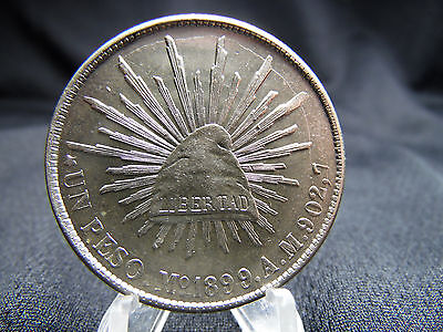 1899 Mexican Un Peso Mo AM which replaced the (8R) 8 Reales Die Crack Obverse
