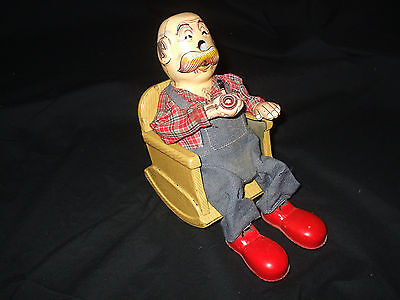 Vintage Battery operated SAN Smoking Grandpa in Rocking Chair Japan Tin Toy