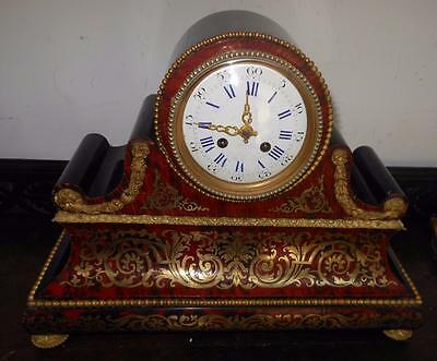 pretty french drumhead striking boulle clock with silk suspension movement