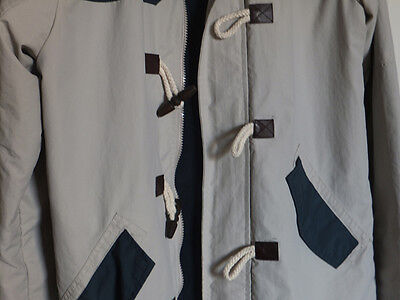 hooded cagoule/jacket with unusual toggle design
