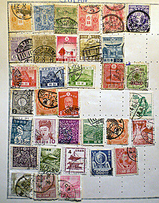 An album page of vintage JAPAN stamps including Imperial Post