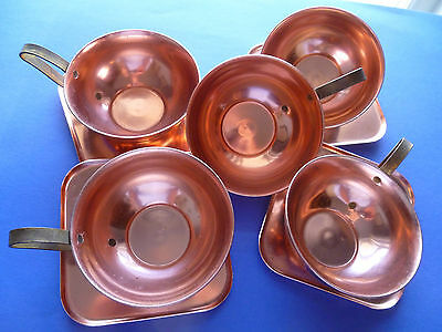 Arts and Crafts Style Copper Cups and Saucers.