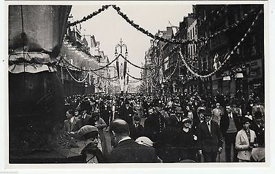 BUSY STREET PROCESSION - Policeman - unlocated -  c1920s era Real Photo postcard