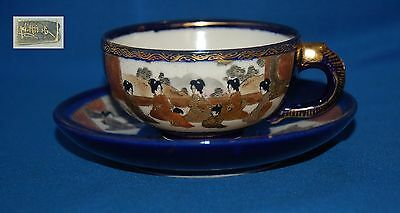 Vintage oriental/Japanese blue & gilt Geisha decorated duo cup and saucer